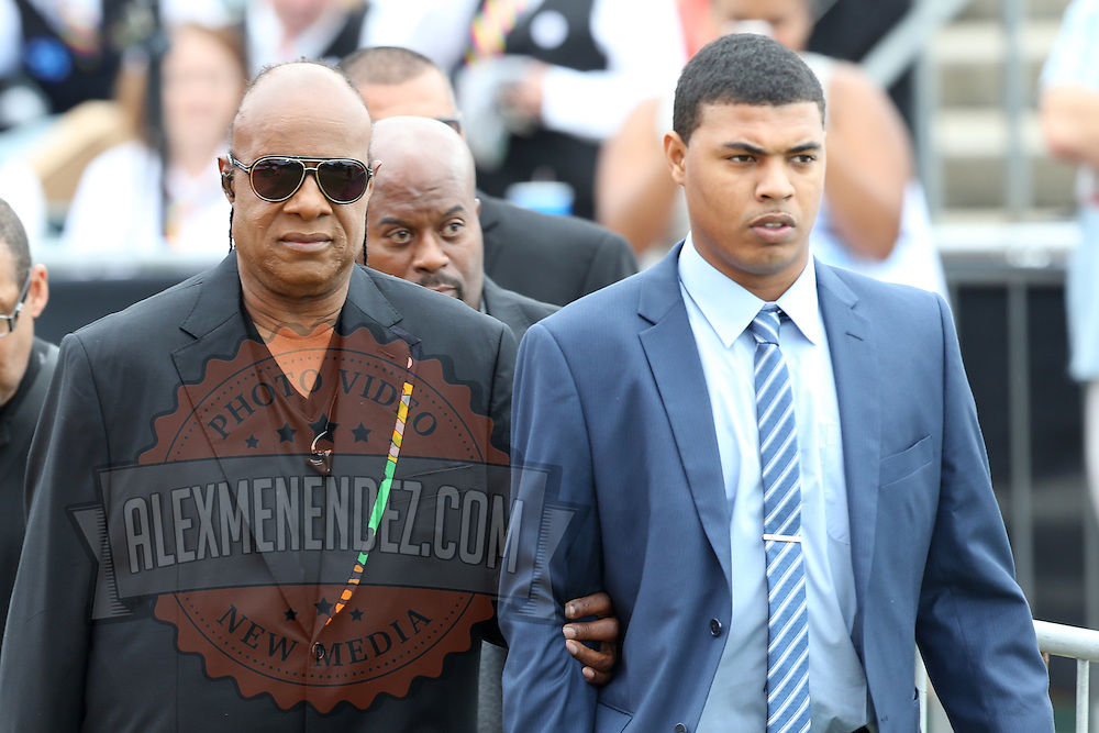 Musician Stevie Wonder is escorted to the stage before he performs prior to President Barack Obama campaigning for Democratic nominee Hillary Clinton at Osceola Park in Kissimmee Florida USA  06 Nov 2016