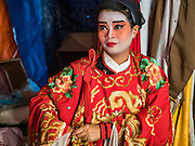 04 OCTOBER 2016 - BANGKOK, THAILAND:  A Chinese opera performer waits to go on stage at the Vegetarian Festival at the Chit Sia Ma Chinese shrine in Bangkok. The Vegetarian Festival is celebrated throughout Thailand. It is the Thai version of the The Nine Emperor Gods Festival, a nine-day Taoist celebration beginning on the eve of 9th lunar month of the Chinese calendar. During a period of nine days, those who are participating in the festival dress all in white and abstain from eating meat, poultry, seafood, and dairy products. Vendors and proprietors of restaurants indicate that vegetarian food is for sale by putting a yellow flag out with Thai characters for meatless written on it in red.    PHOTO BY JACK KURTZ