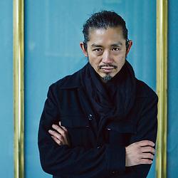 Paris, France. February 27, 2014. Fashion Designer Akira Kurosawa at the Palais Royal. Photo: Antoine Doyen