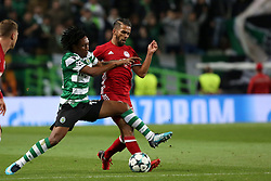 November 22, 2017 - Lisbon, Portugal - Sporting's forward Gelson Martins from Portugal fights for the ball with Olympiacos' Moroccan midfielder Mehdi Carcela-Gonzalez during the UEFA Champions League group D football match Sporting CP vs Olympiacos FC at Alvalade stadium in Lisbon, Portugal on November 22, 2017. Photo: Pedro Fiuza  (Credit Image: © Pedro Fiuza/NurPhoto via ZUMA Press)