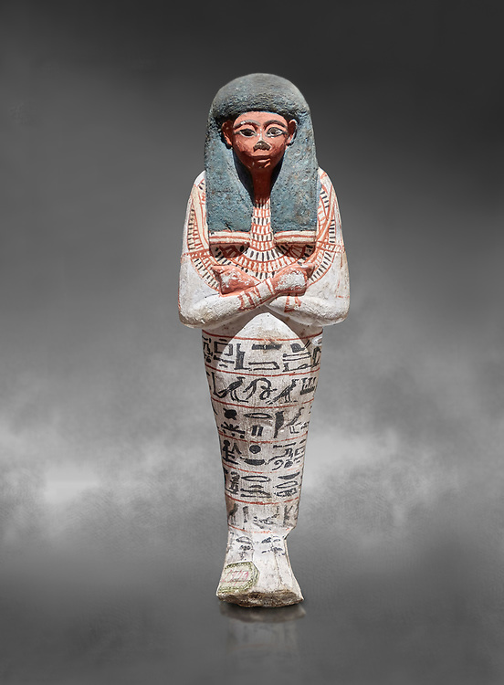 Ancient Egyptian shabtis doll, lwood, New Kingdom, 18th Dynasty, (1538-1040 BC), Deir el Medina. Egyptian Museum, Turin.Grey background. <br /> <br /> shabti figures began to occur in Middle Kingdom tombs with a twofold nature: on <br /> the one hand, they were meant to be images of their owners, representatives of the deceased in the realm of the Lord of Eternity. <br /> On the other hand, they were also considered to be servants of the deceased, taking the role of the servant statues. The complex <br /> nature of the shabti figure as a substitute of both the owner and his or her servants remains unaltered during the New Kingdom .<br /> <br /> If you prefer to buy from our ALAMY PHOTO LIBRARY  Collection visit : https://www.alamy.com/portfolio/paul-williams-funkystock/ancient-egyptian-art-artefacts.html  . Type -   Turin   - into the LOWER SEARCH WITHIN GALLERY box. Refine search by adding background colour, subject etc<br /> <br /> Visit our ANCIENT WORLD PHOTO COLLECTIONS for more photos to download or buy as wall art prints https://funkystock.photoshelter.com/gallery-collection/Ancient-World-Art-Antiquities-Historic-Sites-Pictures-Images-of/C00006u26yqSkDOM