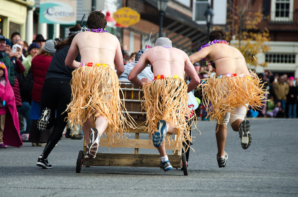 Rear view of racers in the annual Bed Races, which are held every November after the Pajama Sale in Bar Harbor, Maine.