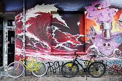 Street art and graffiti on wall of building in bohemian Friedrichshain in Berlin Germany