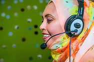Islamic woman working as a customer service representative for a medical company, in Seattle, WA.