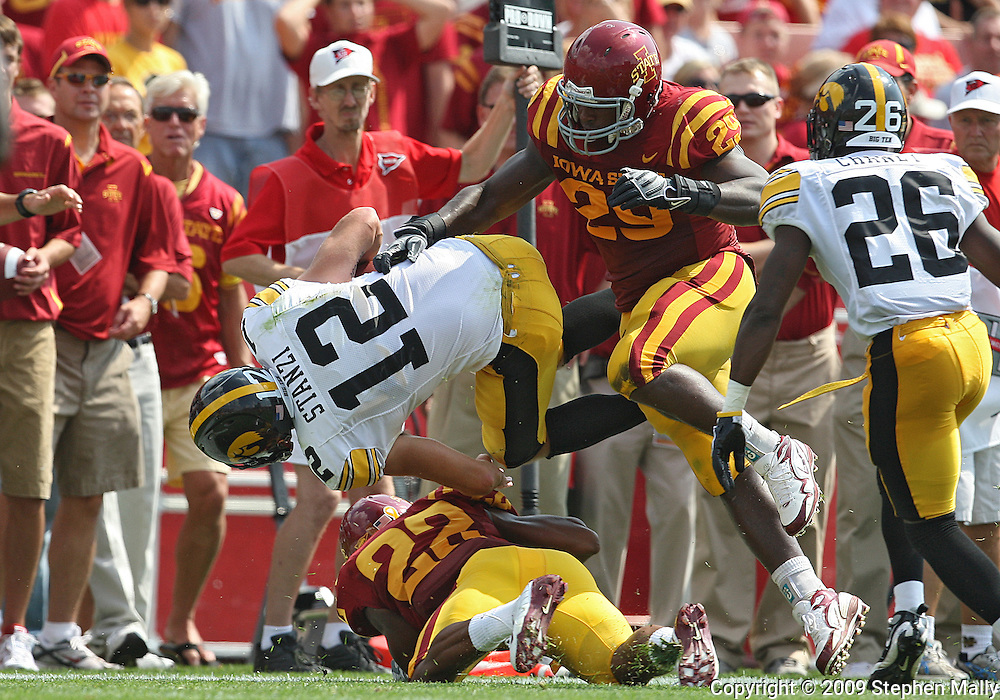 September 12, 2009: Iowa quarterback Richard Stanzi (12) is hit by Iowa State cornerback Ter'ran Benton (22) and Iowa State defensive tackle Rashawn Parker (29) in the third quarter of the Iowa Hawkeyes' 35-3 win over the Iowa State Cyclons at Jack Trice Stadium in Ames, Iowa on September 12, 2009.