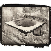 An old ceramic sink bolted to a wall of oine of the cells in the Little Fortress of the Terezin concentration camp in what was Czechoslovakia.