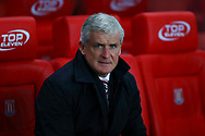 Stoke City Manager Mark Hughes looks on from his seat in the dugout. Premier league match, Stoke City v Liverpool at the Bet365 Stadium in Stoke on Trent, Staffs on Wednesday 29th November 2017.<br /> pic by Chris Stading, Andrew Orchard sports photography.