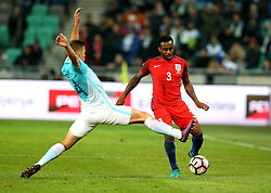 Danny Rose of England passes the ball past Miral Samardzic of Slovenia - Mandatory by-line: Robbie Stephenson/JMP - 11/10/2016 - FOOTBALL - RSC Stozice - Ljubljana, England - Slovenia v England - World Cup European Qualifier