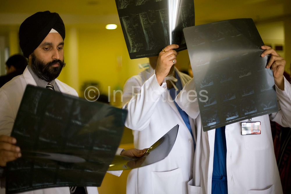 Doctors discuss a patient's x-ray at the Medicity Hospital, Gurgaon<br /> <br /> The Medicity, Gurgaon is India's most technologically advanced multi disciplinary hospital. Founded by India's leading cardiac surgeon, Dr Naresh Trehan, it will when completed also contain a medical school and 1600 beds with over 48 operating theatres.