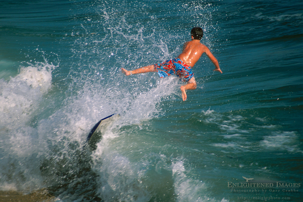 Skimboarder in air Balboa Newport Beach California