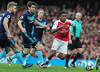 Football - 2016 / 2017 Premier League - Arsenal vs. Middlesbrough<br /> <br /> Alex Iwobi of Arsenal and Ben Gibson of Middlesbrough at The Emirates.<br /> <br /> COLORSPORT/ANDREW COWIE