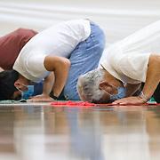 Three men pray during Jumu'ah prayer at Islamic Center of Greater Toledo in Perrysburg, Ohio, on Friday, July 17, 2020. THE BLADE/KURT STEISS