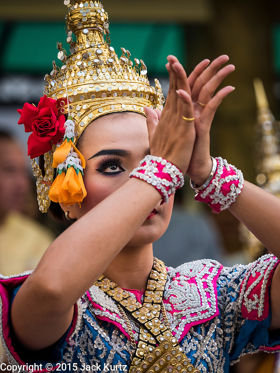 "04 SEPTEMBER 2015 - BANGKOK, THAILAND:  A classical Thai dancer performs in front of the Erawan Shrine Friday. A ""Holy Religious Ceremony for Wellness and Prosperity of our Nation and Thai People"" was held Friday morning at Erawan Shrine. The ceremony was to regain confidence of the Thai people and foreign visitors, to preserve Thai religious customs and traditions and to promote peace and happiness inThailand. Repairs to Erawan Shrine were completed Thursday, Sept 3 after the shrine was bombed on August 17. Twenty people were killed in the bombing and more than 100 injured. The statue of the Four Faced Brahma in the shrine was damaged by shrapnel and a building at the shrine was damaged by debris.    PHOTO BY JACK KURTZ"