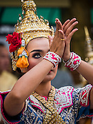 """04 SEPTEMBER 2015 - BANGKOK, THAILAND:  A classical Thai dancer performs in front of the Erawan Shrine Friday. A """"Holy Religious Ceremony for Wellness and Prosperity of our Nation and Thai People"""" was held Friday morning at Erawan Shrine. The ceremony was to regain confidence of the Thai people and foreign visitors, to preserve Thai religious customs and traditions and to promote peace and happiness inThailand. Repairs to Erawan Shrine were completed Thursday, Sept 3 after the shrine was bombed on August 17. Twenty people were killed in the bombing and more than 100 injured. The statue of the Four Faced Brahma in the shrine was damaged by shrapnel and a building at the shrine was damaged by debris.    PHOTO BY JACK KURTZ"""