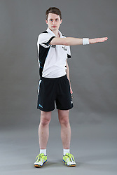 Umpire James Thomas signalling ordering off