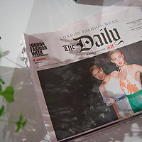 A copy of the The London Fashion Week Daily newspaper lies discarded on a lobby table at the the KTZ spring 2011 collection in the BFC show space at Somerset House, London on 22  September 2010.