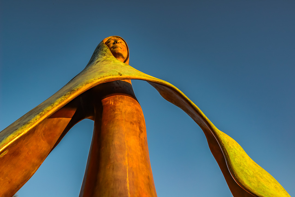 Queen of the Seas and sea shell, bronze sculpture along the Malecon, evening light, February, La Paz, Baja, Mexico