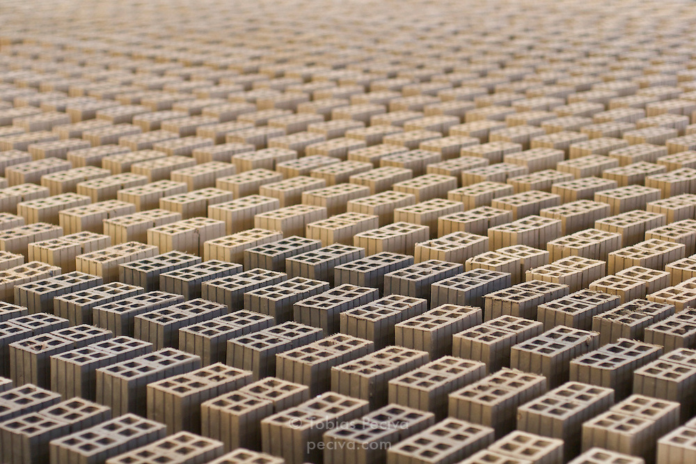 Bricks laid out to dry in a brick factory in the Mekong Delta, Vietnam.