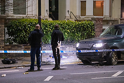 **Incident reported to be connected with the death of Multi-millionaire hotelier Sir Richard Sutton in Dorset**<br /> © Licensed to London News Pictures. 08/04/2021. London, UK. Forensic investigators survey the scene on Chiswick High Road following a incident in which a vehicle was stopped by armed police at approximately 22:30hrs on Wednesday 07/04/2021 when police approached the vehicle, officers discovered the lone male occupant had sustained a number of serious self-inflicted injuries. First aid was commenced immediately and the London Ambulance Service were called. The male has been taken to a west London hospital. Photo credit: Peter Manning/LNP