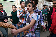 Boys and youth dance to a sound system in the streets to celebrate a wedding, Islamic Cairo, Cairo, Egypt