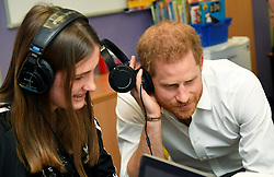 The Duke of Sussex listens to music with patient Esme during a visit to Oxford Children's Hospital, based at the John Radcliffe hospital site in Oxford.