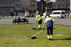 Glasgow, Scotland, UK. 16 May 2021. City cleansing department clearing up damage in George Square after yesterday's mass celebration by Rangers fans following their Premiership league win. Iain Masterton/Alamy Live News