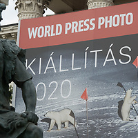 Sculpture is seen in front of the poster of the World Press Photo exhibition on the facade of Hungarian National Museum in Budapest, Hungary on Sept. 23, 2020. ATTILA VOLGYI