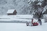 Winter landscape with man using snowblower, Nozawaonsen, Japan