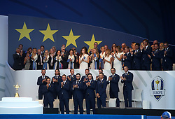Team Europe and their wives and girlfriends behind during the Ryder Cup Opening Ceremony at Le Golf National, Saint-Quentin-en-Yvelines, Paris.