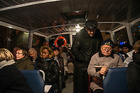 """LYON, FRANCE - DECEMBER 07: People attend mass on a boat with Cardinal Barbarin during The Festival Of Lights on December 7, 2013 in Lyon, France.<br /> For the first time in the history of the festival of lights, Cardinal Barbarin, prelate of Gaul, organizes, on the Saone, a pilgrimage entitled """"Marie over water"""" aboard two small barges."""