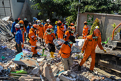 October 1, 2018 - Sulawesi, Indonesia - Rescue members transfer a body at a collapsed hotel in Palu, Central Sulawesi, Indonesia, on Oct. 1, 2018. Over 1,203 people were killed in Palu, Donggala district, Parigi Mountong district and North Mamuju district, according to the Disaster Management Institute of Indonesia, Care for Humanity and the Humanity Data Center.  lrz) (Credit Image: © Iqbal Lubis/Xinhua via ZUMA Wire)