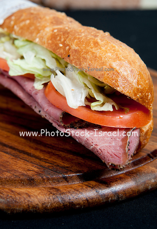 Cold meat sandwich (brisket) on a wooden plater