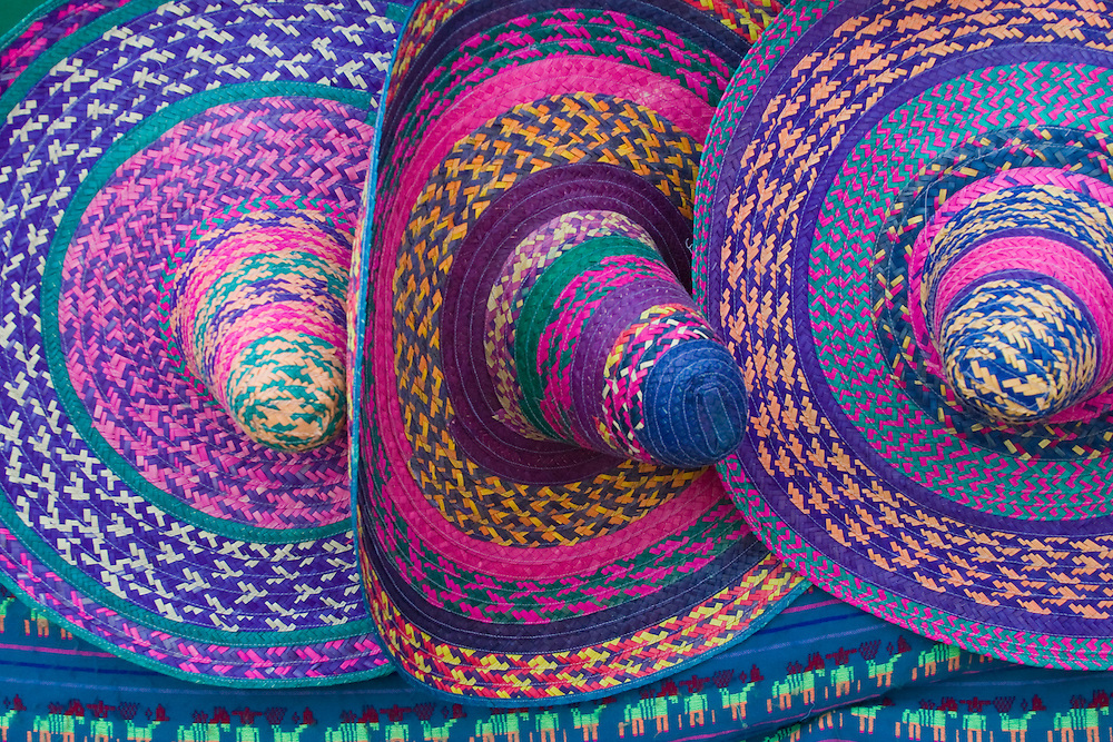 Mexico, Yucatan, Merida, traditional woven sombrero hats on display at market