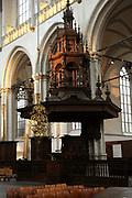 De Nieuwe Kerk is een kerkgebouw in Amsterdam. De kerk is gelegen aan de Dam, naast het Paleis op de Dam.De Nieuwe Kerk wordt, sinds soeverein-vorst Willem in 1814 in deze kerk de eed op de grondwet aflegde, ook gebruikt voor de inzegening van koninklijke huwelijken en voor inhuldigingen. De inhuldiging van Koningin Beatrix vond er plaats op 30 april 1980. Op dezelfde datum in 2013 zal de inhuldiging van haar zoon en opvolger Willem-Alexander ook daar plaatsvinden.<br /> <br /> The New Church is a church building in Amsterdam. The church is located on Dam Square, next to the Palace on the Dam.De New Church in this church in 1814, since sovereign-prince Willem laid aside the oath to the Constitution, also used for the blessing of royal weddings and inaugurations. The inauguration of Queen Beatrix took place on April 30, 1980. On the same date in 2013, the inauguration of her son and heir Willem-Alexander will also take place there.<br /> <br /> Op de foto / On the photo: Preekstoel / pulpit