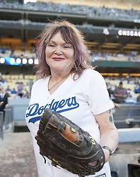 August 16, 2017 - Los Angeles, California, U.S - 16 Aug 2017. The Los Angeles Dodgers play the Chicago White Sox in the second game of a two-game series at Dodger Stadium. Pictured is Singer Exene Cervenka from the Los Angeles band X throwing the ceremonial first pitch. (Credit Image: © Prensa Internacional via ZUMA Wire)