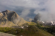 Warbonnet Peak and the Warrior in the clouds, The Cirque of the Towers, from just below Texas Pass on Skunk Knob in the Wind River Range, mountains in the Shoshone National Forest, Fremont County, Wyoming, USA.