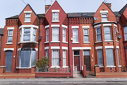 Occupied property flanked by two boarded up houses in an area of Bootle; Liverpool; England part of the pathfinder regeneration scheme,