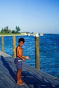 Young boy holding fishing line, Cayman Brac, Cayman Islands, West Indies c 1990