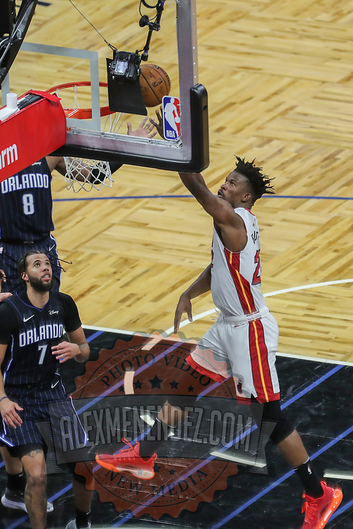 ORLANDO, FL - MARCH 14: Jimmy Butler #22 of the Miami Heat drives to the net in front of Michael Carter-Williams #7 of the Orlando Magic during the second half at Amway Center on March 14, 2021 in Orlando, Florida. NOTE TO USER: User expressly acknowledges and agrees that, by downloading and or using this photograph, User is consenting to the terms and conditions of the Getty Images License Agreement. (Photo by Alex Menendez/Getty Images)*** Local Caption *** Jimmy Butler; Michael Carter-Williams