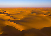 "SAUDI ARABIA FROM ABOVE<br /> It only takes a few minutes to get from Najran to the golden sands of the Rub Al Khali, the ""Empty Quarter"" Desert. This is one of the places that the late British explorer Wilfred Thesiger visited. A local Saudi rabbit hunter who lost his greyhound used the drone pictures to locate his dog."