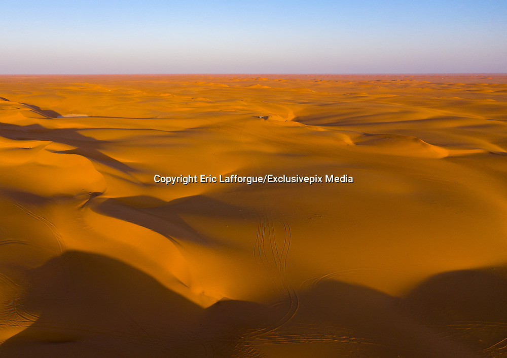 """SAUDI ARABIA FROM ABOVE<br /> It only takes a few minutes to get from Najran to the golden sands of the Rub Al Khali, the """"Empty Quarter"""" Desert. This is one of the places that the late British explorer Wilfred Thesiger visited. A local Saudi rabbit hunter who lost his greyhound used the drone pictures to locate his dog."""