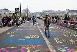 London, UK. 16th April 2019. Climate change activists from Extinction Rebellion occupy Waterloo Bridge on the second day of International Rebellion activities to call on the British government to take urgent action to combat climate change.