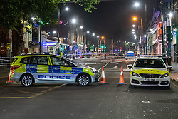 © Licensed to London News Pictures. 22/07/2021. London, UK. Police vehicles form a cordon with a forensic tent in the background at the scene following a fatal stabbing on Brixton Road, Brixton. Metropolitan Police Service (MPS) were called at 20:18BST on Wednesday 21 July to reports of an assault close to Brixton Underground Station. Despite efforts from police officers, paramedics from London Ambulance Service (LAS) and London's Air Ambulance the man was pronounced dead at the scene at the 20:45BST. Photo credit: Peter Manning/LNP