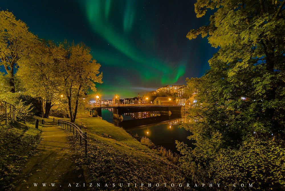 A beautiful October night in Trondheim. You can see northern light over Trondheim downtown. In this picture you can see gamlebybro (town bridge) and beautiful river called nidelva. Please feel free to find me by: |Website| ,