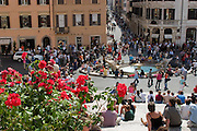 """Shoppers and tourists mingle on the Spanish Steps in Rome, Italy. The steps, known as """"The Scalinata"""" in Italian, are the longest and widest staircase in Europe."""