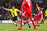 Burton Albion defender Keiran Wallace (22) and Accrington Stanley midfielder Sam Finley (14) during the EFL Sky Bet League 1 match between Burton Albion and Accrington Stanley at the Pirelli Stadium, Burton upon Trent, England on 23 March 2019.