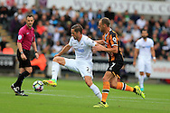 Gylfi Sigurdsson of Swansea city is challenged by David Meyler of Hull city. Premier league match, Swansea city v Hull city at the Liberty Stadium in Swansea, South Wales on Saturday 20th August 2016.<br /> pic by Andrew Orchard, Andrew Orchard sports photography.