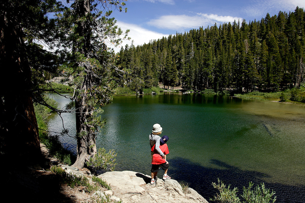 MAMMOTH, CA, AUG 22, 2006:  A mother and her son enjoy the view of Emerald Lake in Mammoth, California  on August 22, 2006  (Photograph by Todd Bigelow/Aurora).