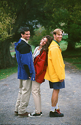 three people enjoying time together outdoors