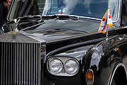 Awaiting the Lord May of London to emerge from St Paul's Cathedral after an official function, the flag of the 'Corporation of London' hangs on the polished chrome of his official Rolls Royce, on 22nd June 2021, in London, England.